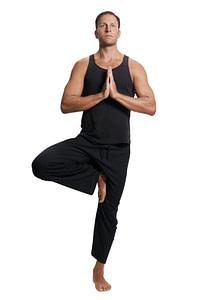 Man doing yoga tree pose
