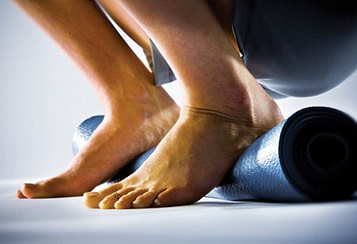 If your heels don't come to the floor, place a folded, firm blanket or rolled yoga mat underneath them.