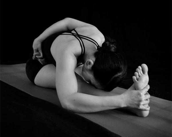 Ardha Baddha Padma Paschimottanasana, Half Bound Lotus Forward Bend